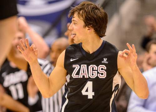 Trent Nelson  |  The Salt Lake Tribune Gonzaga Bulldogs guard Kevin Pangos (4) celebrates a three-pointer as BYU hosts Gonzaga, men's college basketball at the Marriott Center in Provo, Saturday December 27, 2014.