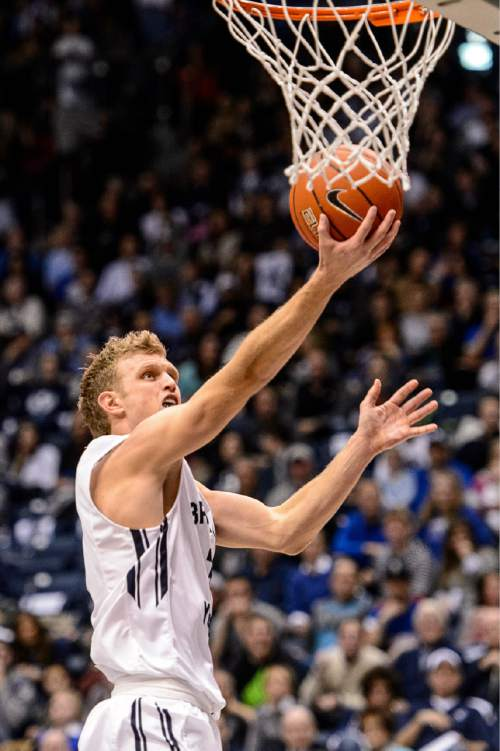 Trent Nelson  |  The Salt Lake Tribune Brigham Young Cougars guard Tyler Haws (3) shoots the ball as BYU hosts Gonzaga, men's college basketball at the Marriott Center in Provo, Saturday December 27, 2014.