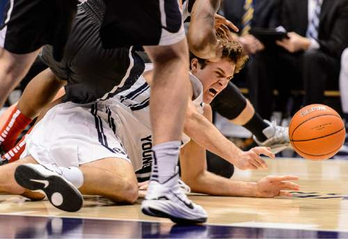 Trent Nelson  |  The Salt Lake Tribune Brigham Young Cougars forward Luke Worthington (41) dives for a loose ball as BYU hosts Gonzaga, men's college basketball at the Marriott Center in Provo, Saturday December 27, 2014.