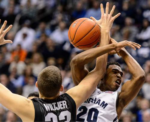 Trent Nelson  |  The Salt Lake Tribune Gonzaga Bulldogs forward Kyle Wiltjer (33) knocks the ball away from Brigham Young Cougars guard Anson Winder (20) as BYU hosts Gonzaga, men's college basketball at the Marriott Center in Provo, Saturday December 27, 2014.