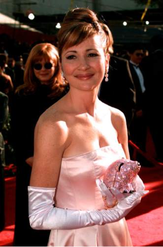 """FILE - In this March 25, 1996 file photo, Christine Cavanaugh arrives for the 68th Academy Awards at the Music Center in Los Angeles. Cavanaugh, 51, a prolific voice actress whose characters included the titular character of """"Babe,"""" has died. Cavanaugh's sister Deionn Masock confirmed Tuesday, Dec. 30, 2014, that Cavanaugh died December 22 at her home in Utah. (AP Photo/Mark J. Terrill, File)"""