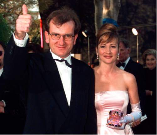 """FILE - In this March 25, 1996 file photo, Director of """"Babe"""" Chris Noonan, left, and the voice of """"Babe"""" Christine Cavanaugh, right, arrive for the 68th Academy Awards at the Music Center in Los Angeles. Cavanaugh, 51, a prolific voice actress whose characters included the titular character of """"Babe,"""" has died. Cavanaugh's sister Deionn Masock confirmed Tuesday, Dec. 30, 2014, that Cavanaugh died December 22 at her home in Utah.   (AP Photo/Kevork Djansezian, File)"""