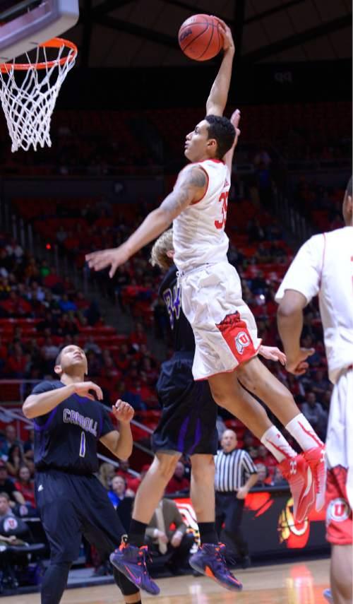 Leah Hogsten  |  The Salt Lake Tribune Utah Utes forward Kyle Kuzma (35) stuffs the net. The University of Utah leads Carroll College 54-23 Tuesday, December 30, 2014 at the Jon M. Huntsman Center.