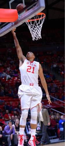 Leah Hogsten  |  The Salt Lake Tribune Utah Utes forward Jordan Loveridge (21) hits the net. The University of Utah leads Carroll College 54-23 Tuesday, December 30, 2014 at the Jon M. Huntsman Center.