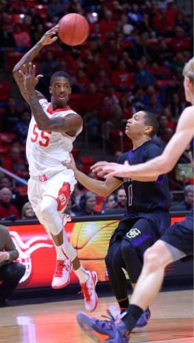 Leah Hogsten  |  The Salt Lake Tribune Utah Utes guard Delon Wright (55) with the running pass. The University of Utah leads Carroll College 54-23 Tuesday, December 30, 2014 at the Jon M. Huntsman Center.