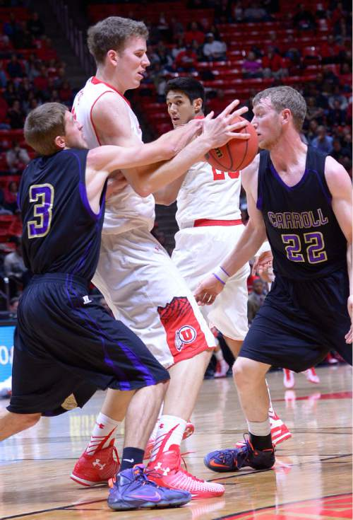 Leah Hogsten  |  The Salt Lake Tribune Carroll College's Zach Taylor knocks the ball from the hands of Utah Utes forward Jakob Poeltl (42). The University of Utah leads Carroll College 54-23 Tuesday, December 30, 2014 at the Jon M. Huntsman Center.