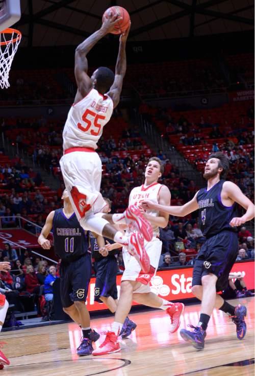 Leah Hogsten  |  The Salt Lake Tribune Utah Utes guard Delon Wright (55) stuffs the net. The University of Utah leads Carroll College 54-23 Tuesday, December 30, 2014 at the Jon M. Huntsman Center.