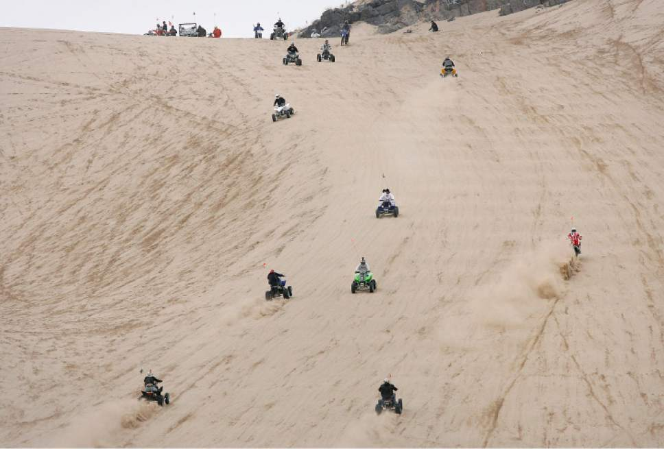 "Scott Sommerdorf  |  Tribune file photo  A variety of vehicles power up the ""Sand Mountain"" incline at Little Sahara Recreation Area."