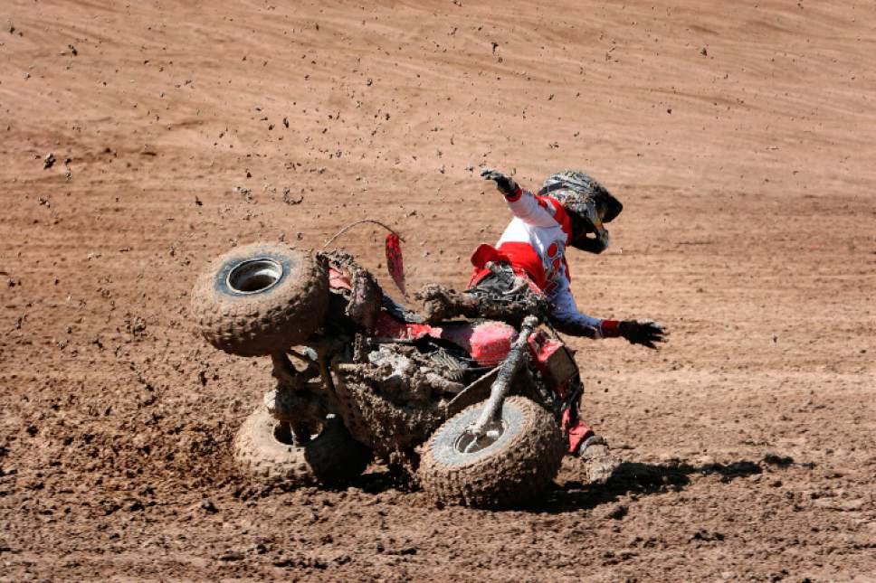 (Tribune file photo)  Avery Rasmussen crashes his three-wheeler at Little Sahara Recreation Area.