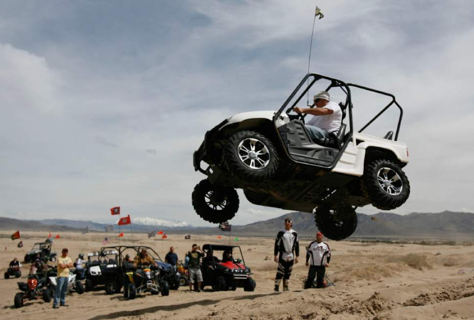 Francsco Kjolseth  |  Tribune file photo Chevy Hastings of Spanish Fork puts hits Yamaha Rhino to the test at Little Sahara Recreation Area. Sand Mountain, the largest sand dune in the recreation area, is a popular spot for hill climbers.