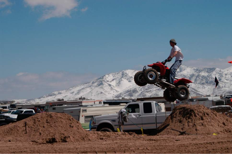 Tom Wharton  |  Tribune file photo An ATV rider uses a jump made of sand to take some air at Little Sahara Recreation Area's Sand Mountain.