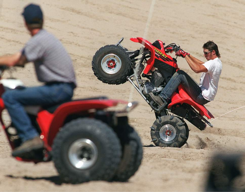 Al Hartmann  |  Tribune file photo Holiday weekends are popuar with ATV riders at Little Sahara Recreation Area's Sand Mountain.