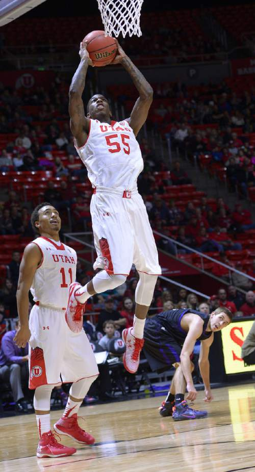 Utah guard Delon Wright (55) goes up for dunk against Carroll during an NCAA college basketball game Tuesday, Dec. 30, 2014, in Salt Lake City. (AP Photo/The Salt Lake Tribune, Leah Hogsten)