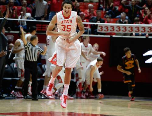 Scott Sommerdorf   |  The Salt Lake Tribune Utah Utes forward Kyle Kuzma (35) jumps as he celebrates a 3-point shot by little-used Utah Utes guard Austin Eastman (15) as he got some playing time late in the rout. Utah defeated the USC Trojans 79-55, Friday, January 2, 2015.