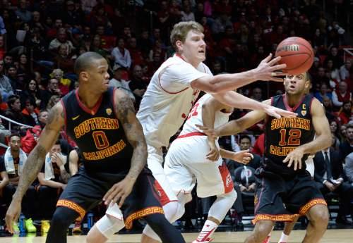 Scott Sommerdorf   |  The Salt Lake Tribune Utah Utes center Dallin Bachynski (31) reaches for a loose ball during second half play. Utah defeated the USC Trojans 79-55, Friday, January 2, 2015.