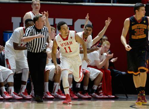Scott Sommerdorf   |  The Salt Lake Tribune The Utah bench celebrates another 3-point shot by Utah Utes guard Brandon Taylor (11) during second half play. Utah defeated the USC Trojans 79-55, Friday, January 2, 2015.