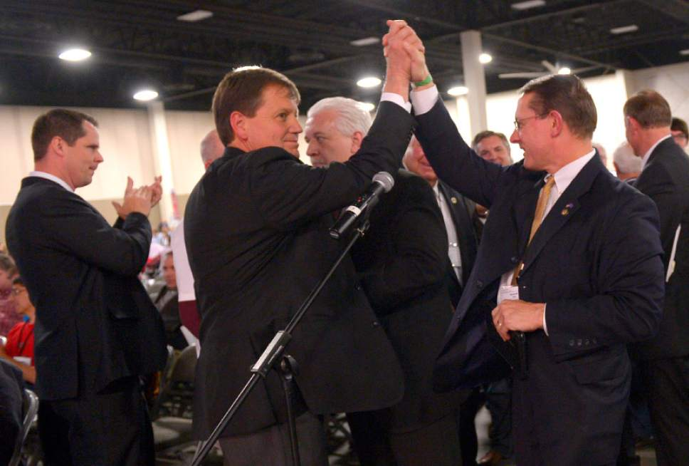 Leah Hogsten  |  The Salt Lake Tribune Rep. Ken Ivory, R-West Jordan (right) high-fives Rep. Kevin Stratton, R-Orem (left) after Ivory's resolution to demand the federal government transfer control of oil-, timber -and mineral-rich lands to western states passed at the Utah Republican Party 2014 Nominating Convention at the South Towne Expo Center, Saturday, April 26, 2014.