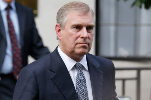 FILE- In this Wednesday, June 6, 2012 file photo, Britain's Prince Andrew leaves King Edward VII hospital in London after visiting his father Prince Philip. Reacting to U.S. court documents, royal officials issued a statement on Friday, Jan. 2, 2015 denying that Britain's Prince Andrew engaged in sexual impropriety with a minor. (AP Photo/Sang Tan, File)