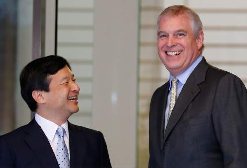 Britain's Prince Andrew, the Duke of York, right, is welcomed by Japanese Crown Prince Naruhito upon his arrival at Togu Palace in Tokyo Tuesday, Oct. 1, 2013. Andrew is in Tokyo to attend a two-day Japan-UK security cooperation conference. (AP Photo/Koji Sasahara)