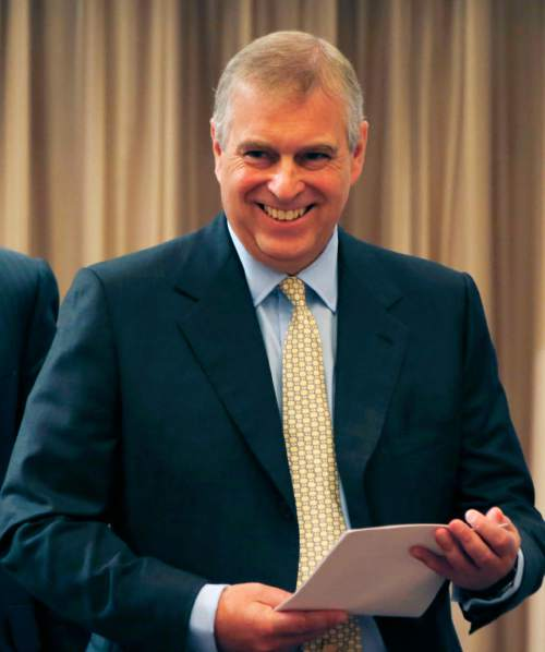 Britain's Prince Andrew, the Duke of York, smiles after delivering the keynote speech of the Japan-UK security cooperation conference in Tokyo, Tuesday, Oct. 1, 2013. (AP Photo/Koji Sasahara)