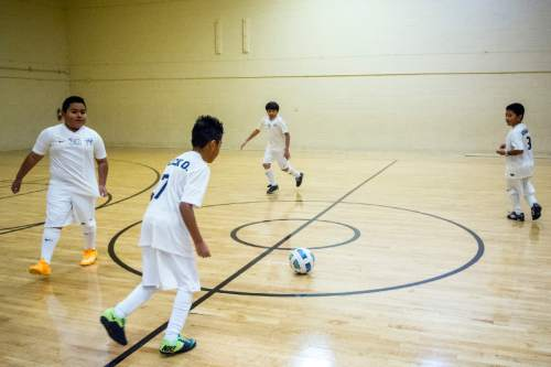 Chris Detrick     The Salt Lake Tribune Alberto Garcia, 10, Eric Ortiz, 10, Benjamin Campos, 9, and Angel Perez, 10, play soccer at Centro Civico Mexicano Tuesday December 30, 2014. Centro Civico Mexicano, Utah's oldest Latino organization, has been at its present locale in Salt Lake City's Depot District since 1939. It is now being surrounded by development projects as downtown moves westward and hundreds of newly constructed apartment units change the once-blighted industrial neighborhood. Generations of Spanish-speaking Utahns are emotionally attached to Centro Civico and the agency does not want to move. It has its own plans for development, with an overhaul of its building, addition of new sports and education facilities, and a cluster of senior housing units.