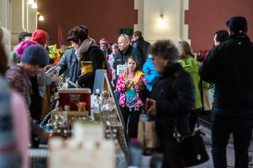 Chris Detrick     The Salt Lake Tribune People shop for locally produced goods at the Winter Farmers Market at the Rio Grande Depot Saturday January 3, 2015.