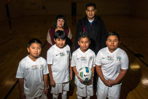 Chris Detrick     The Salt Lake Tribune President Brandy Farmer, Director and coach Arsenio Gonzalez, Alberto Garcia, 10, Eric Ortiz, 10, Benjamin Campos, 9, and Angel Perez, 10, pose for a portrait at Centro Civico Mexicano Tuesday December 30, 2014. Centro Civico Mexicano, Utah's oldest Latino organization, has been at its present locale in Salt Lake City's Depot District since 1939.   It is now being surrounded by development projects as downtown moves westward and hundreds of newly constructed apartment units change the once-blighted industrial neighborhood. Generations of Spanish-speaking Utahns are emotionally attached to Centro Civico and the agency does not want to move. It has its own plans for development, with an overhaul of its building, addition of new sports and education facilities, and a cluster of senior housing units.