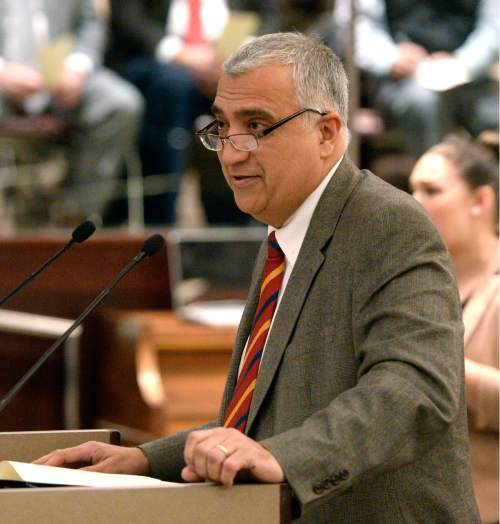 Al Hartmann  |  The Salt Lake Tribune Salt Lake County Council District Attorney, Sim Gill speaks to gathered at the Salt Lake County Council chamber Monday January 5 after being administered the oath of office.
