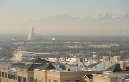 Al Hartmann  |  The Salt Lake Tribune View from the Gateway looking southwest to the Oquirrh Mountains across the valley.    Air pollution, (pm 2.5) begins building up in downtown Salt Lake City Tuesday Jan. 6.  It looks worse than it is.  The Utah Department of Environmental Quality's measurement was about 20  for pm 2.5, putting it into the yellow mandatory action range.  Stay tuned for more of the same for the next few days.