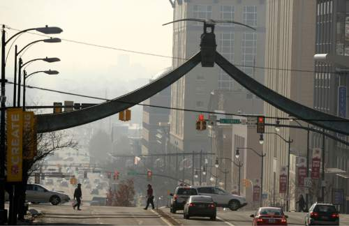 l Hartmann  |  The Salt Lake Tribune View looking south down State Street from North Temple Street.  Air pollution, (pm 2.5) begins building up in downtown Salt Lake City Tuesday Jan. 6.  It looks worse than it is.  The Utah Department of Environmental Quality's measurement was about 20  for pm 2.5, putting it into the yellow mandatory action range.  Stay tuned for more of the same for the next few days.