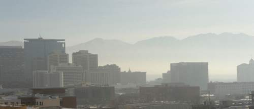 Al Hartmann  |  The Salt Lake Tribune View from the Gateway looking east to downtown Salt Lake City.   Air pollution, (pm 2.5) begins building up in downtown Salt Lake City Tuesday Jan. 6.  It looks worse than it is.  The Utah Department of Environmental Quality's measurement was about 20  for pm 2.5, putting it into the yellow mandatory action range.  Stay tuned for more of the same for the next few days.