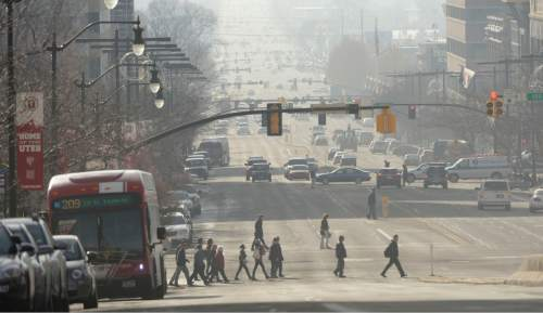 l Hartmann  |  The Salt Lake Tribune View looking south down State Street from South Temple Street.  Air pollution, (pm 2.5) begins building up in downtown Salt Lake City Tuesday Jan. 6.  It looks worse than it is.  The Utah Department of Environmental Quality's measurement was about 20  for pm 2.5, putting it into the yellow mandatory action range.  Stay tuned for more of the same for the next few days.