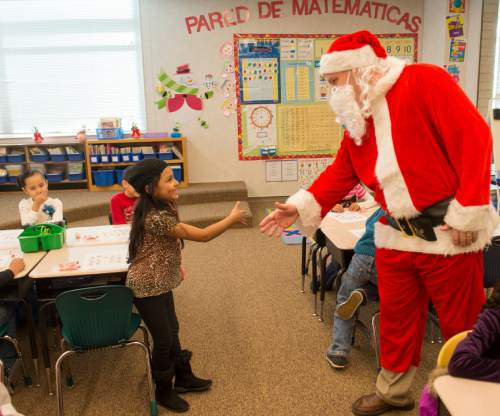 "Rick Egan  |  The Salt Lake Tribune  Ken Limb, principal of Mountain View Elementary School, surprises students as he enters the class room to see if they are still on the ""nice"" list, Friday, December 19, 2014"