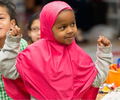 Rick Egan  |  The Salt Lake Tribune  Kindergarten student, Maryam Yasin, dances to Christmas music at Mountain View Elementary School, Friday, December 19, 2014