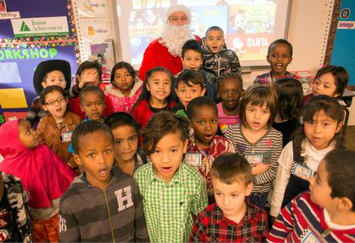 Rick Egan  |  The Salt Lake Tribune  Ken Limb, principal of Mountain View Elementary School, dressed like Santa Claus, poses for photo with kindergarten students, Friday, December 19, 2014