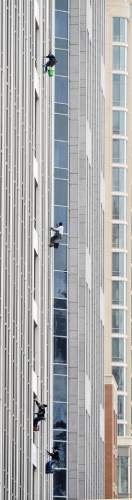 Steve Griffin  |  The Salt Lake Tribune   Window cleaners take advantage of the warmer weather as they team-up to clean windows on buildings in Salt Lake City, Monday, January 5, 2015.