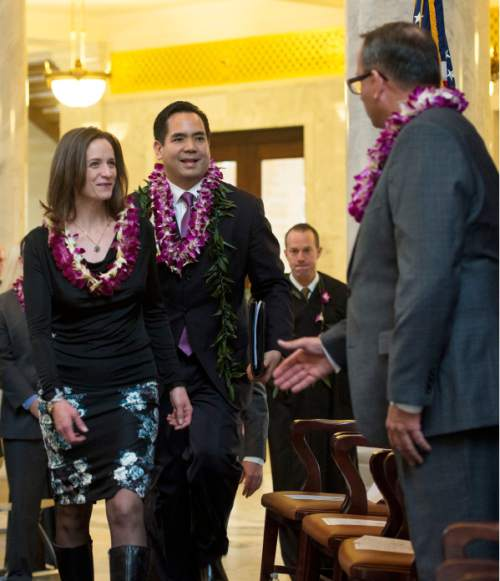 Steve Griffin  |  The Salt Lake Tribune   Attorney General Sean Reyes escorts his wife, Saysha, to their seats during his inaugural program in the Utah Capitol Rotunda in Salt Lake City, Monday, Jan. 5, 2015.