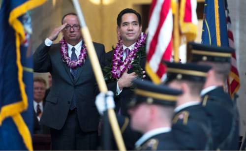 Steve Griffin  |  The Salt Lake Tribune   Attorney General Sean Reyes holds his hand over his heart as he listens to the One Voice Children's Choir sing the national anthem during his inaugural program in the Utah Capitol Rotunda in Salt Lake City, Monday, Jan. 5, 2015.