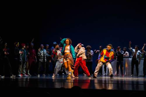 This picture represents the Golden era of the stage performance They Reminisce; The mid 1980's to the 1990's is known as the golden era of hip hop. This era represents a block parties and club dances. Performed in a cypher (or circle of dancers).