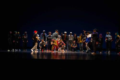The first Bboys (Breakdancers) date back to the late 1970's. This picture represents a bboy battle; a competition between two dancers or two crews (a group of dancers) battling one after another to see who had the best dance moves.
