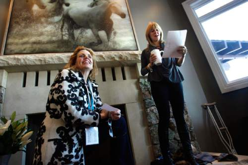 """Scott Sommerdorf  l  The Salt Lake Tribune Geralyn Dreyfous (left), listens as Jacki Zehner reads a greeting to her guests. Dreyfous was at the Zehner home to continue her film promotion tour of """"Miss Representation"""", Sunday, 1/23/2011."""