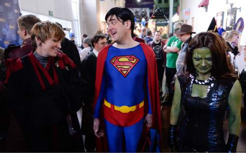 Francisco Kjolseth  |  The Salt Lake Tribune Cosplayers Brooke Wilkins, Eric Hall and Mindy Madsen, from left, dress up for prizes as organizers of Salt Lake Comic Con announce Jan. 29-31 as the dates for the 2015 FanX celebration at a press event at the Megaplex 17 at Jordan Common in Sandy on Wednesday, Nov. 19, 2014.