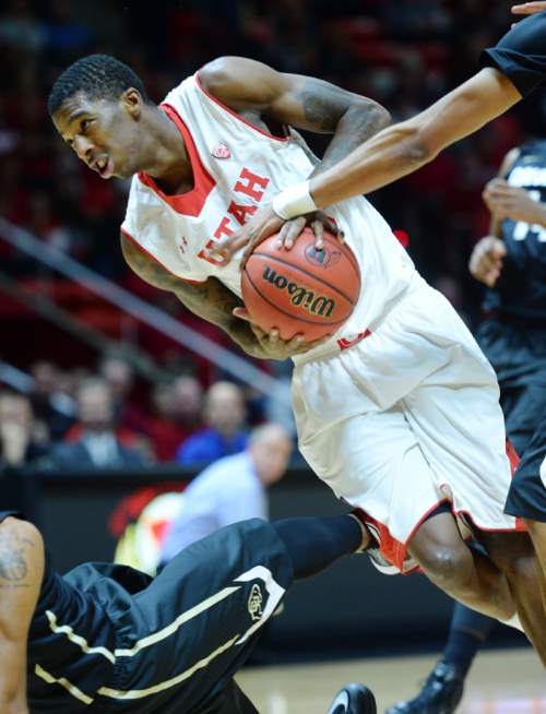 Steve Griffin  |  The Salt Lake Tribune   Utah Utes guard Delon Wright (55) crashes into Colorado Buffaloes guard Xavier Talton (3) drawing a charging foul during first half action in the Utah versus Colorado men's basketball game at the Huntsman Center in Salt Lake City, Wednesday, January 7, 2015.
