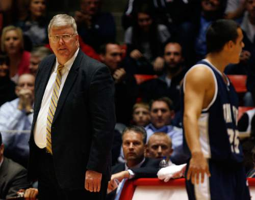 Steve Griffin  |  The Salt Lake Tribune  Salt Lake City - Utah State head coach Stew Morrill scowls at his players late in the game against Utah at the Huntsman Center  in Salt Lake City  Wednesday Nov 18, 2009.