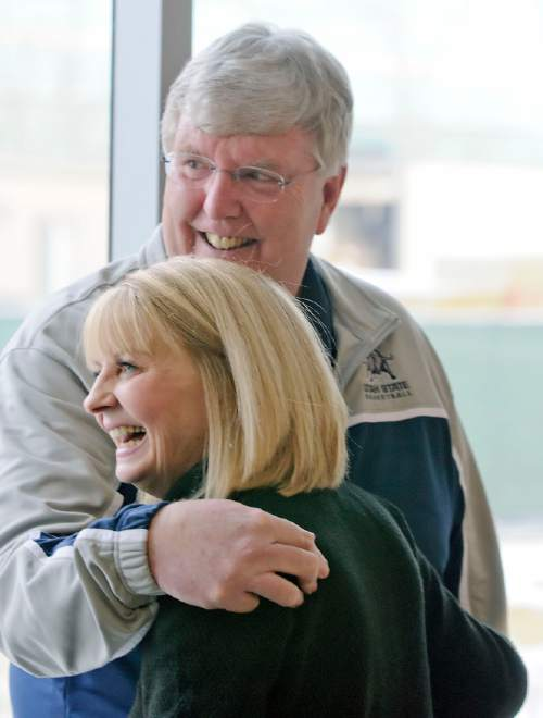 Utah State basketball coach Stew Morrill stands next to his wife Vicki Morrill following a press conference, Friday, Jan. 9, 2014, in Logan, Utah, where he announced that he will retire at the end of the season. (AP Photo/The Herald Journal, Eli Lucero)