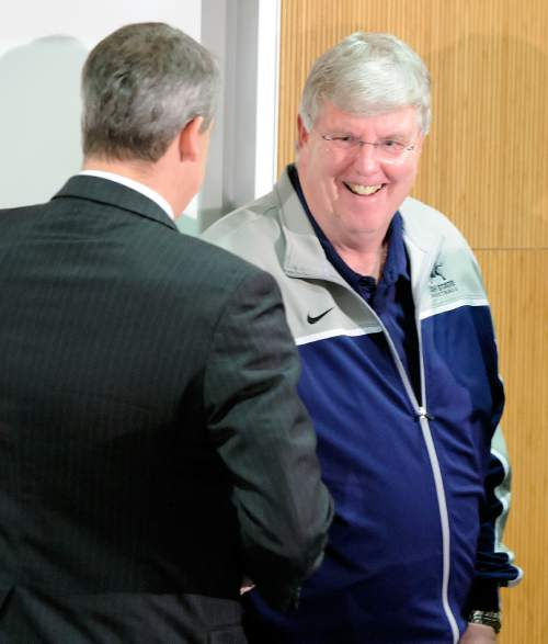 Utah State basketball coach Stew Morrill talks to athletics director Scott Barnes before a press conference, Friday, Jan. 9, 2014, in Logan, Utah, where Morrill announced that he will retire at the end of the season. (AP Photo/The Herald Journal, Eli Lucero)