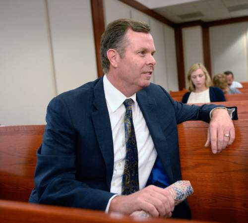 Al Hartmann  |  Tribune file photo  Former Attorney General John Swallow, appearing on criminal charges in July 2014, is refusing to testify in the fraud trial or Marc and Stephen Jenson.