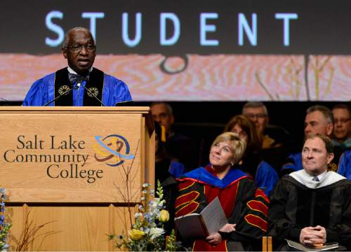 Trent Nelson  |  The Salt Lake Tribune Pastor France Davis speaks at the inauguration of Deneece Huftalin, who becomes the 8th president of Salt Lake Community College after a year as interim president, in Taylorsville, Friday January 9, 2015. Utah Governor Gary Herbert at right.