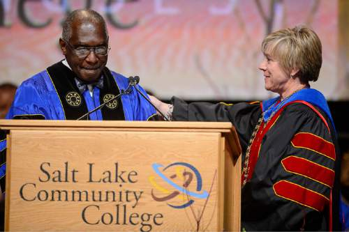 Trent Nelson  |  The Salt Lake Tribune Pastor France Davis speaks at the inauguration of Deneece Huftalin, right, as president of Salt Lake Community College in Taylorsville, Friday January 9, 2015.
