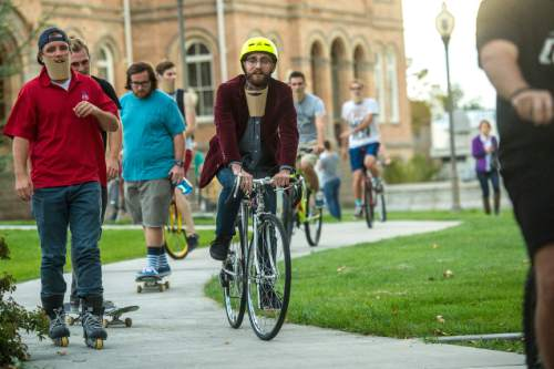 "Chris Detrick  |  Tribune file photo Beard supporters and enthusiasts ride from Provo City Library to Brigham Young University during a ""bike for beards"" rally Friday September 26, 2014.  Shane Pittson is petitioning school officials for the right to bear a beard. The university's honor code -- its mandatory contract that forbids premarital sex, drinking alcohol and tattoos, among other things -- outlaws any scruff on campus."